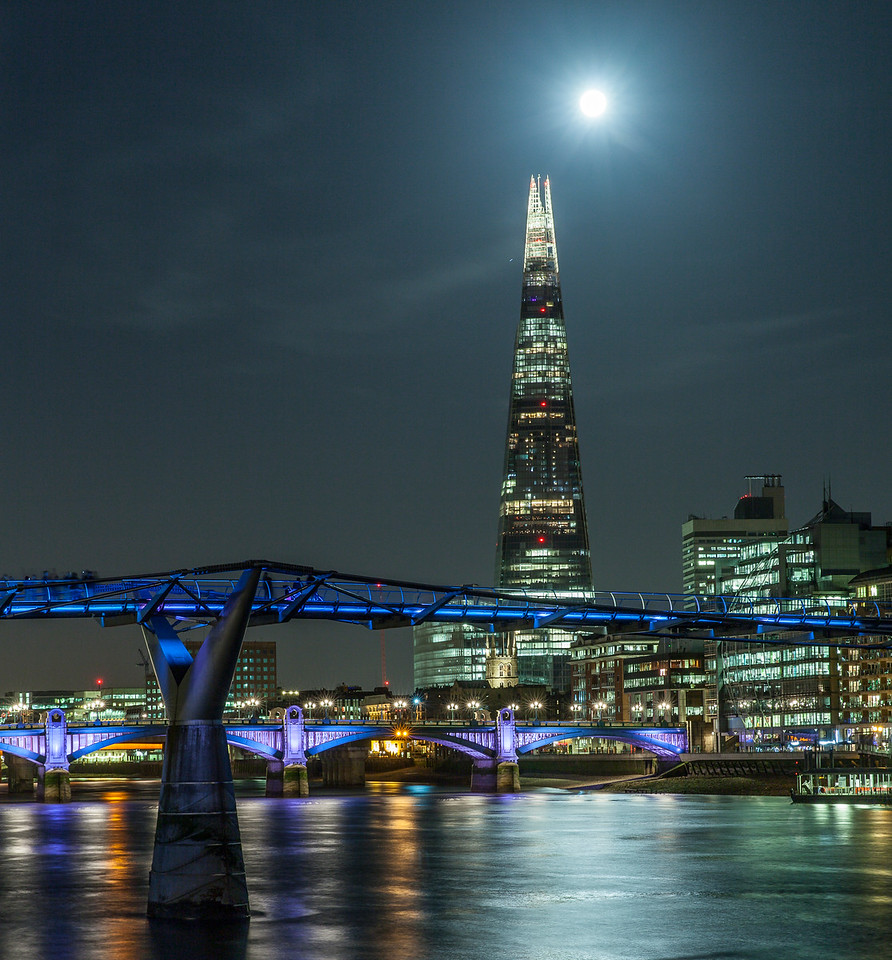 The Millennium Bridge and the Shard on a moonlit night.