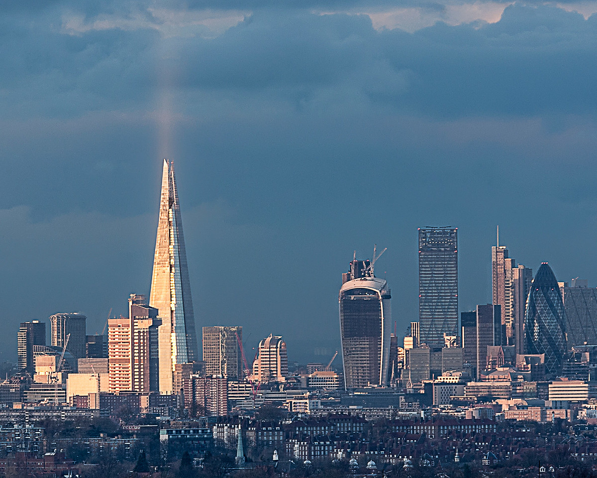 Shaft of sunlight hits The Shard and reflects into the air in this fabulous sun blessed view of the City of London from the heights of Crystal Palace in South London
