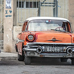 Red and Orange Old American Cars in Havana in Cuba