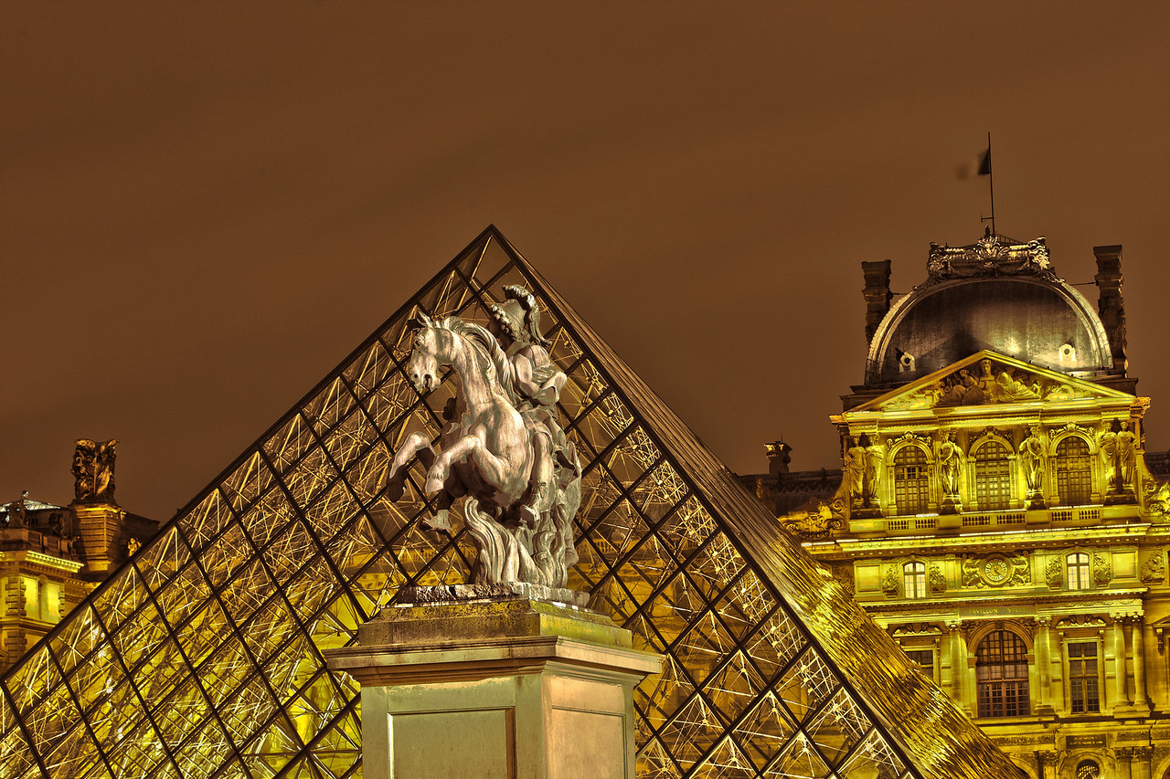 Glass Pyramid and the Louvre Museum in Paris at night