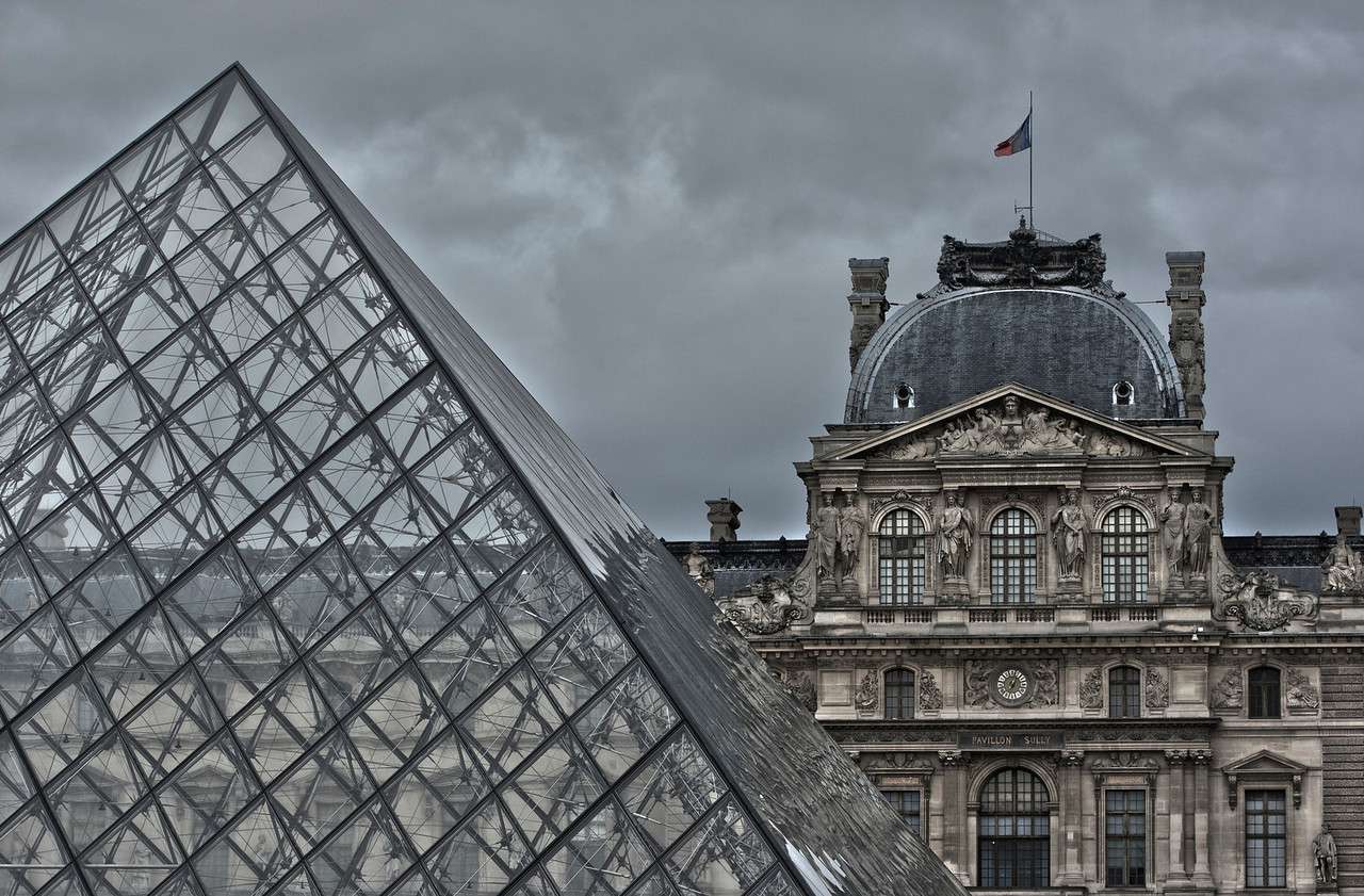 Glass Pyramid next to the Louvre Museum in Paris, France