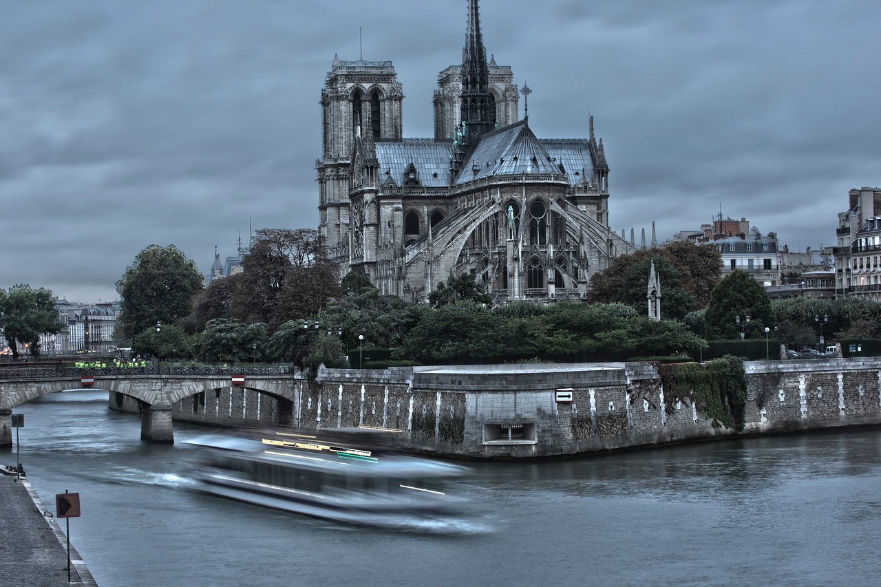 Boat on the River Seine in front of Notre Dame Cathedral in Paris