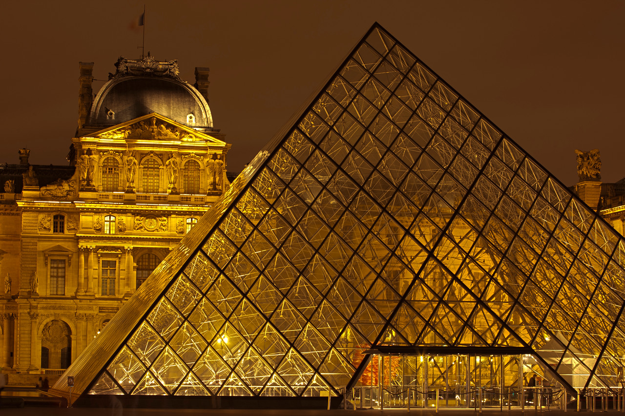 Glass Pyramid lit up in front of the Louvre Museum in Paris at night