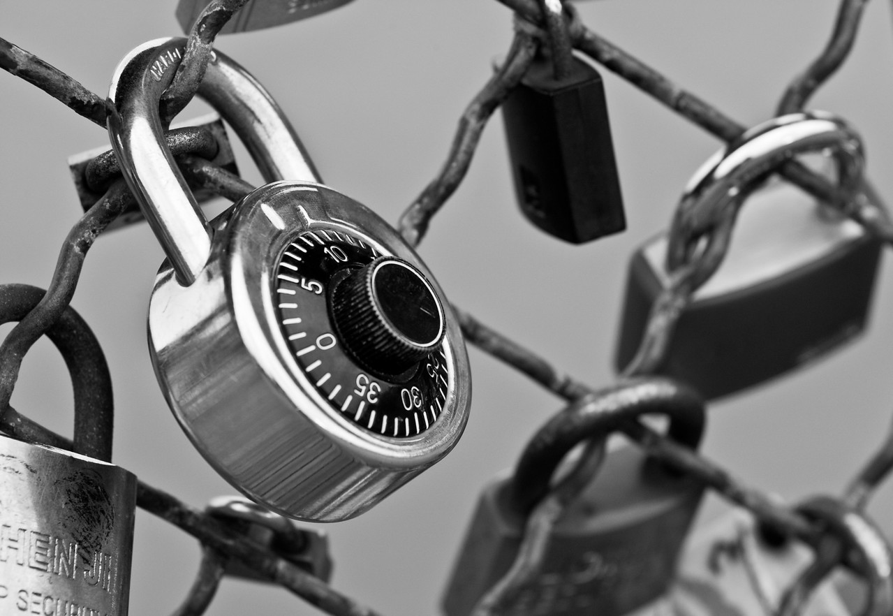 Close up of a padlock on a grille on a bridge over the River Seine in Paris.